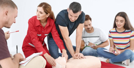 group of students doing cpr